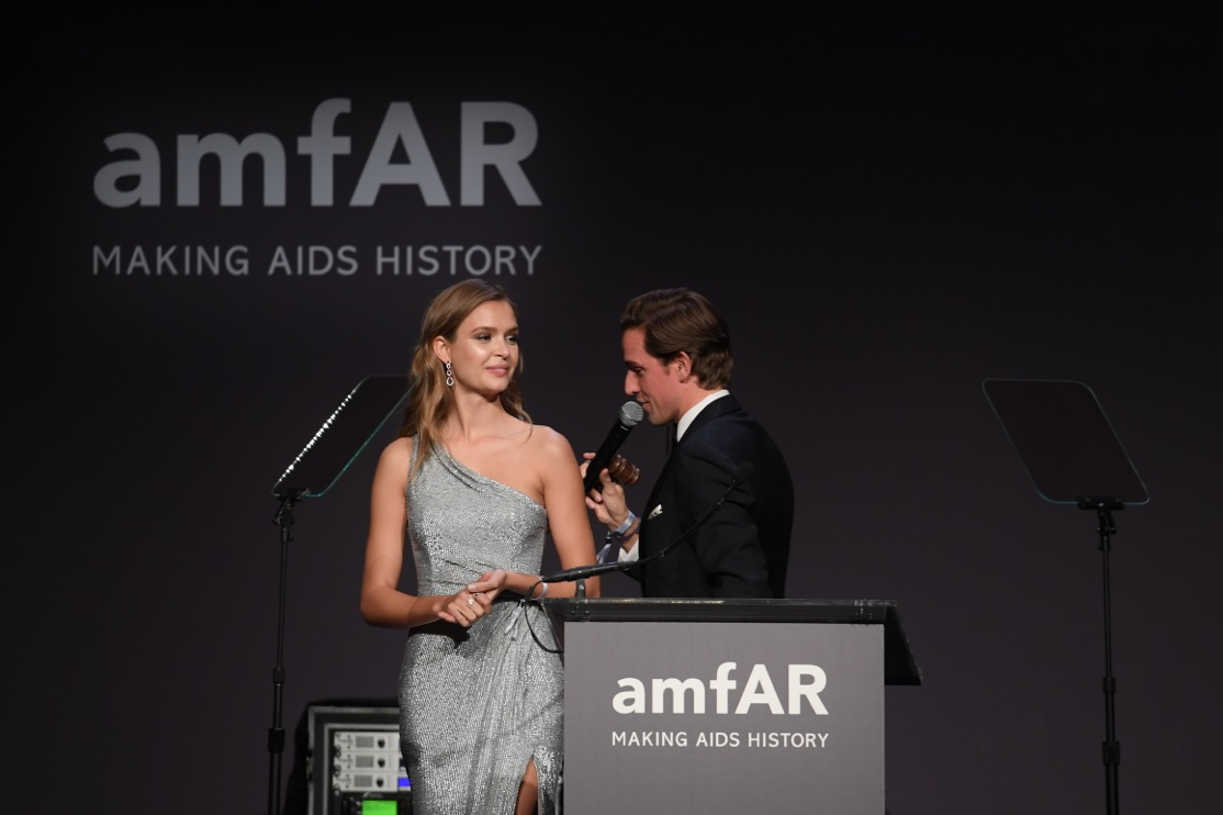 Josephine Skriver wears Harry Winston earrings during auction at amfAR New York 2017. Photo via Getty Images.