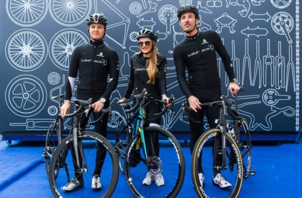 F1 World Champion Nico Rosberg, Nel-Olivia Waga and Olympic Gold Medalist Fabian Cancellara at the IWC bike ride during Laureus World Sports Awards in Monaco.