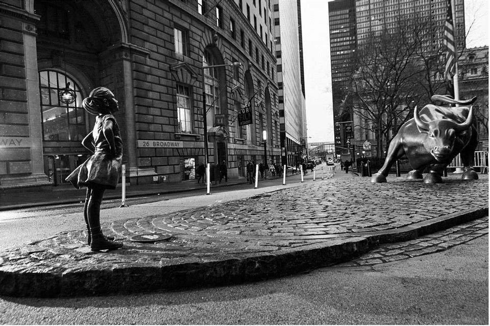 The Fearless Girl on Wall Street facing The Charging Bull. A campaign for International Women's Day by State Street Global Advisors. Photo via Business Wire