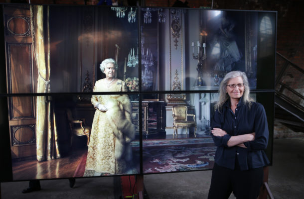 © Licensed to London News Pictures. This image is free to use ONLY in connection with the launch of the 'WOMEN: New Portraits' exhibition. 13/1/2016. London, UK. UBS and Annie Leibovitz launch 'WOMEN:New Portraits' at Wapping Hydraulic Power Station. Here Annie stands with an earlier portrait of Queen Elizabeth II. The exhibition opens to the public from Saturday 16th January until 7th February 2016. The newly commissioned photographs by the world renowned photographer will travel to 10 cities over the course of twelve months – London, Tokyo, San Francisco, Singapore, Hong Kong, Mexico City, Istanbul, Frankfurt, New York and Zurich. Access will be free to the public. Photo credit: Peter Macdiarmid.