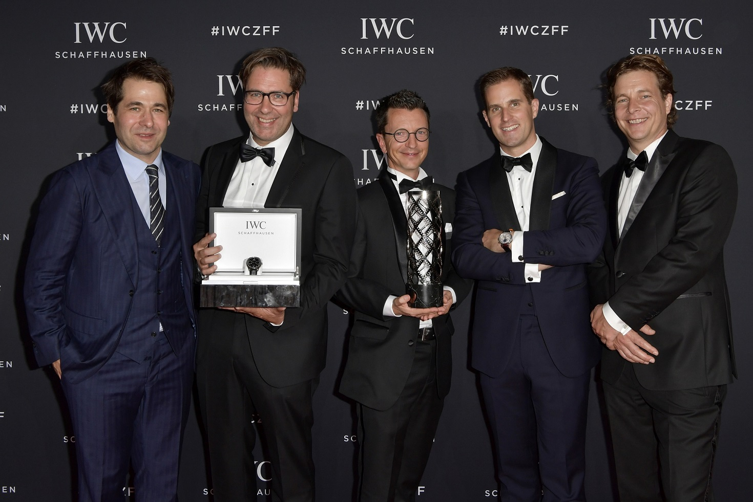 ZURICH, SWITZERLAND - SEPTEMBER 30: Zurich Film Festival director Karl Spoerri (L) and CEO IWC Schaffhausen Christoph Grainger-Herr (2nd R) pose with the winners director Niklaus Hilber (2nd L), producer Valentin Greutert (C) and co-producer Philip Delaquis at the IWC 'For the Love of Cinema' Gala Dinner at AURA Zurich on 30 September, 2017 in Zurich, Switzerland. During the event, actor James Marsden presented the third 'Filmmaker Award', a sponsorship worth CHF 100,000. The award was set up by the Association for the Promotion of Film in Switzerland ('Verein zur Filmförderung in der Schweiz').  (Photo by Harold Cunningham/Getty Images for IWC)